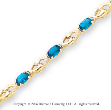 14k Yellow Gold 11 Stone Oval Blue Topaz Tennis Bracelet