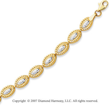 14k Two Tone Gold 7.25in Elegant Oval Carved Bracelet
