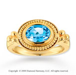 14k Yellow Gold Simple Elegance Oval Blue Topaz Ring