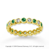 1/2 Carat Emerald and Diamond 14k Yellow Gold Eternity Band