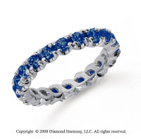 1 1/2 Carat Blue Sapphire Platinum Round Four Prong Eternity Band