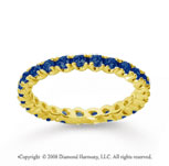 3/4 Carat Blue Sapphire 14k Yellow Gold Round Four Prong Eternity Band