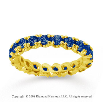 1 1/2 Carat Blue Sapphire 14k Yellow Gold Round Four Prong Eternity Band