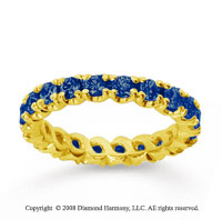 1 1/2 Carat Blue Sapphire 18k Yellow Gold Round Four Prong Eternity Band