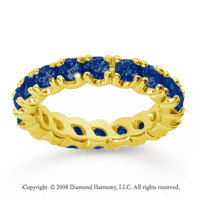 2 1/2 Carat Blue Sapphire 18k Yellow Gold Round Four Prong Eternity Band