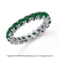 1 1/2 Carat  Emerald Platinum Round Four Prong Eternity Band