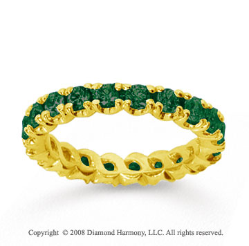 1 1/2 Carat  Emerald 14k Yellow gold Round Four Prong Eternity Band