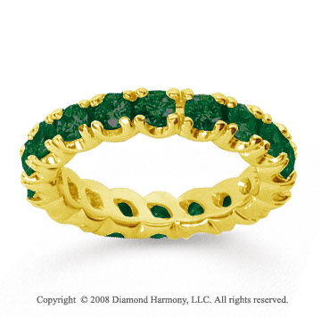 2 1/2 Carat  Emerald 18k Yellow gold Round Four Prong Eternity Band
