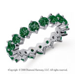 2 1/2 Carat Emerald Platinum Round Open Prong Eternity Band