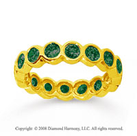 1 1/2 Carat Emerald 18k Yellow Gold Round Bezel Eternity Band