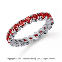 1 1/2 Carat Ruby Platinum Round Four Prong Eternity Band