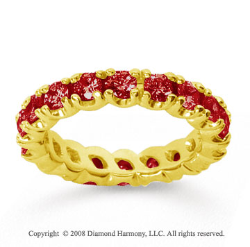 2 1/2 Carat Ruby 14k Yellow Gold Round Four Prong Eternity Band