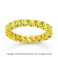 1 1/2 Carat Yellow Sapphire 14k Yellow Gold Round Four Prong Eternity Band