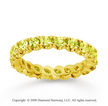 1 1/2 Carat Yellow Sapphire 18k Yellow Gold Round Four Prong Eternity Band
