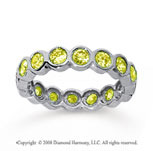 1 1/2 Carat Yellow Sapphire 18k White Gold Round Bezel Eternity Band