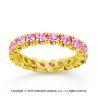 1 1/2 Carat Pink Sapphire 14k Yellow Gold Round Four Prong Eternity Band