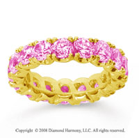 4 1/2 Carat Pink Sapphire 14k Yellow Gold Round Four Prong Eternity Band