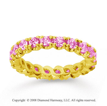 1 1/2 Carat Pink Sapphire 18k Yellow Gold Round Four Prong Eternity Band