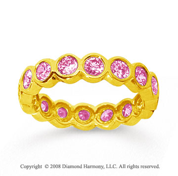 1 1/2 Carat Pink Sapphire 18k Yellow Gold Round Bezel Eternity Band